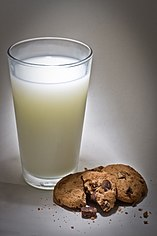 Presidents Choice -The Decadent, chocolate chip cookie, with a glass of milk.jpg